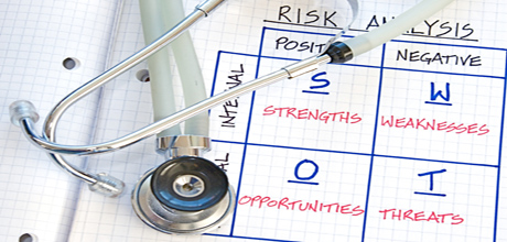 SWOT chart and stethoscope