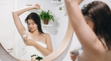 Woman shaving underarms