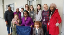 SMHS student and group of staff members from Stellenbosch University stand smiling