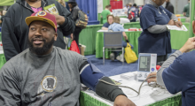 Trenin Jones gets his blood pressure taken at the GW Ron and Joy Kidney Center/GW Transplant Institute booth at the NBC4 Health and Fitness Expo on Saturday, Jan. 9.