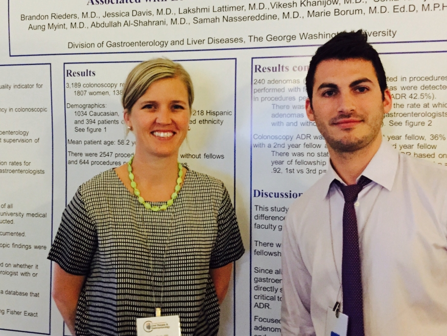 Brandon Rieders with colleague and poster