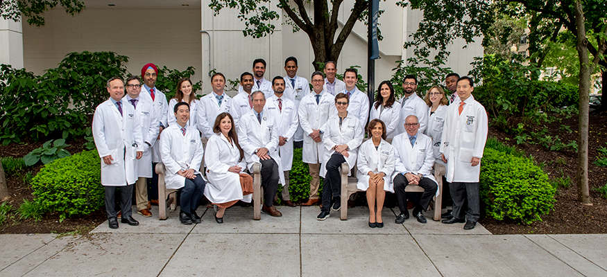 Cardiology faculty wearing white coats outside in 2019