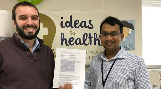GW Researchers holding research paper on Hidradenitis Suppurativa