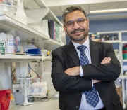 Dr. Sanjay Maggirwar posing with his arms crossed in his lab.