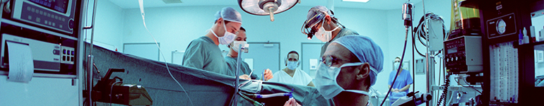 surgeons at operating table