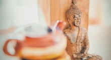 Photo of the Buddha and a meditation bowl