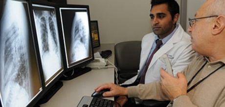 Physicians looking at screen