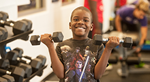 Kid with dumbbells