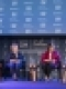 Rodham community sitting with Hilary Clinton on stage Thumbnail
