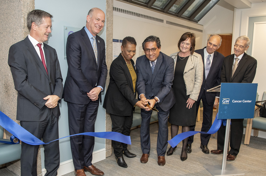GW Cancer Center Director Eduardo Sotomayor, MD, cuts the ribbon on new out-patient cancer clinical space.