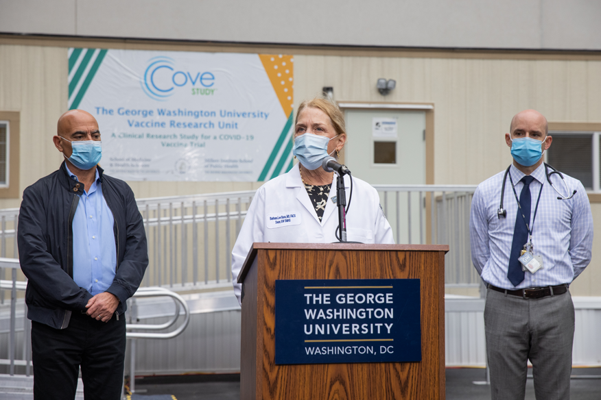 From left: Moncef Slaoui, PhD, MBA, chief adviser for Operation Warp Speed; GW SMHS Dean Barbara L. Bass, MD; and GW COVID-19 vaccine trial PI DavidDiemert, MD.