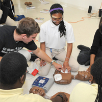 Students practicing hands on CPR