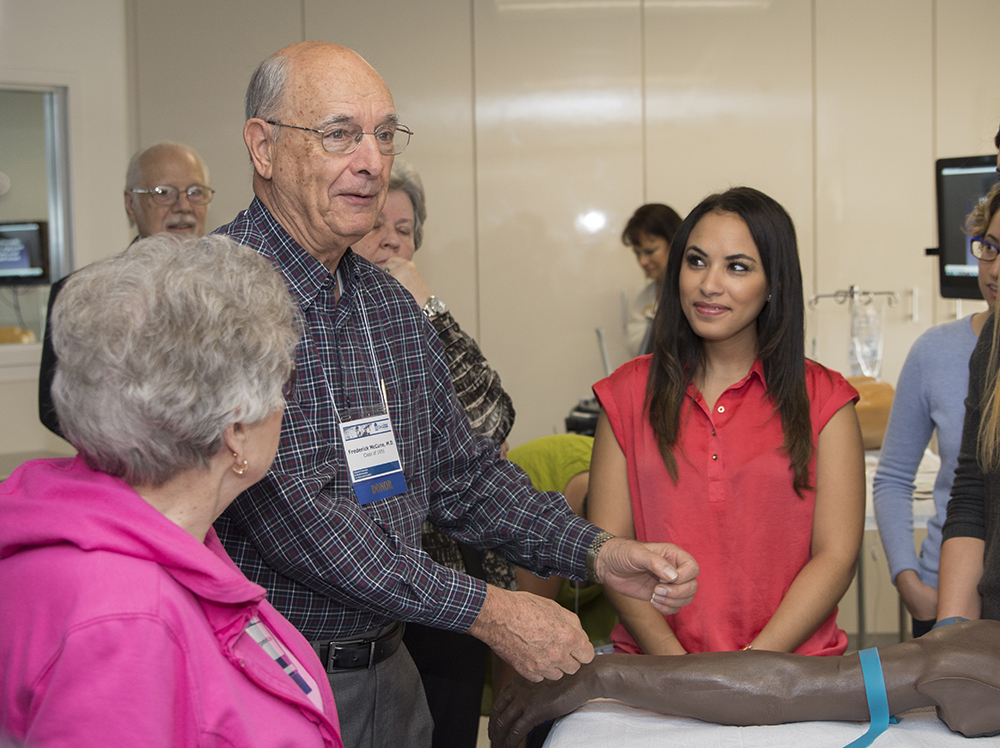 Frederick McCune, M.D. '55, talks with students and fellow alumni in the CLASS Center during Alumni Reunion Weekend.