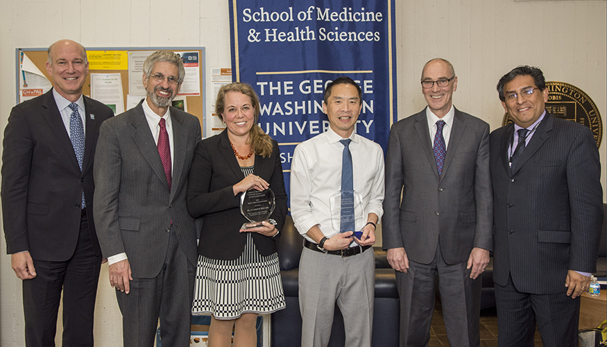 Norman Lee, PhD, and Catherine Bollard, MD, received awards at the 2017 Faculty Research Awards