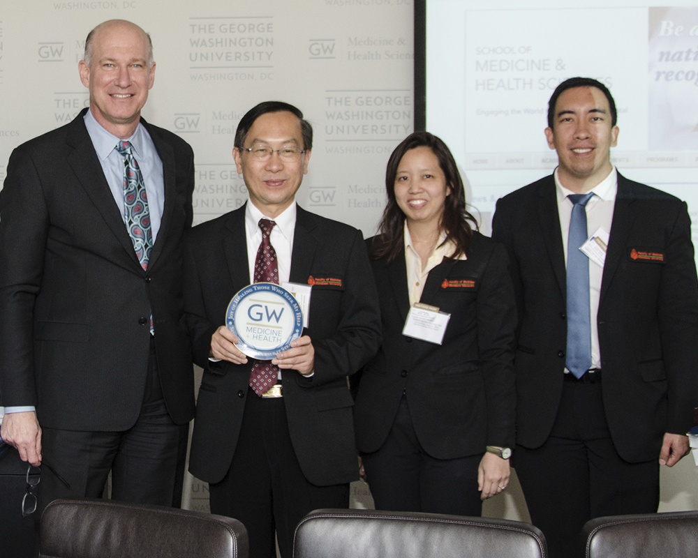 Jeffrey S. Akman, M.D., vice president for health affairs, Walter A. Bloedorn Professor of Administrative Medicine, and dean at the GW School of Medicine and Health Sciences, pictured with a delegation from the Khon Kaen University in Thailand