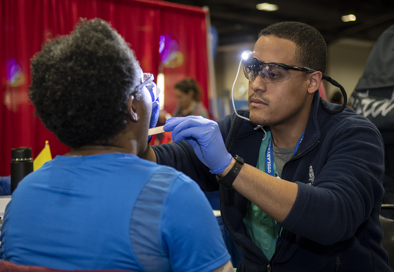 Man examines a patient at the NBC4 Expo