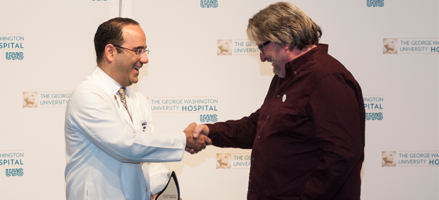 Dr. Babak Sarani welcomes his former patient Wayne Millner back to GW Hospital. Mr. Millner was attacked by a zebra at the National Zoo last fall.