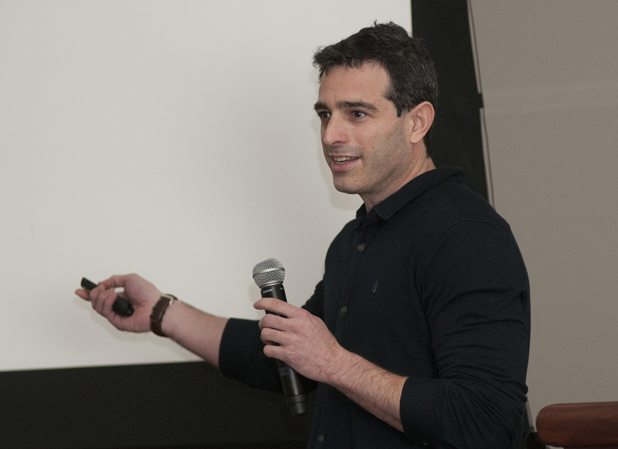 "Keynote speaker Yoav Gilad, Ph.D., presents ""Buffering of Protein Expression Within and Between Species"" at the 5th Annual Neuroscience Symposium on May 1."