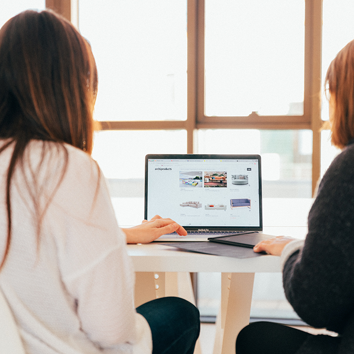Two Women using a computer