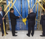 Men with scissors cutting ribbons