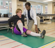 A physical therapy student practices his skills.