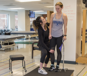Physical therapy students practice their skills.