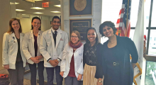 Students pose with legislative aides from Senator Dick Durbin's (D-Ill.) office during the #ProtectOurPatients campaign.