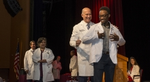 MD student receives his short white coat