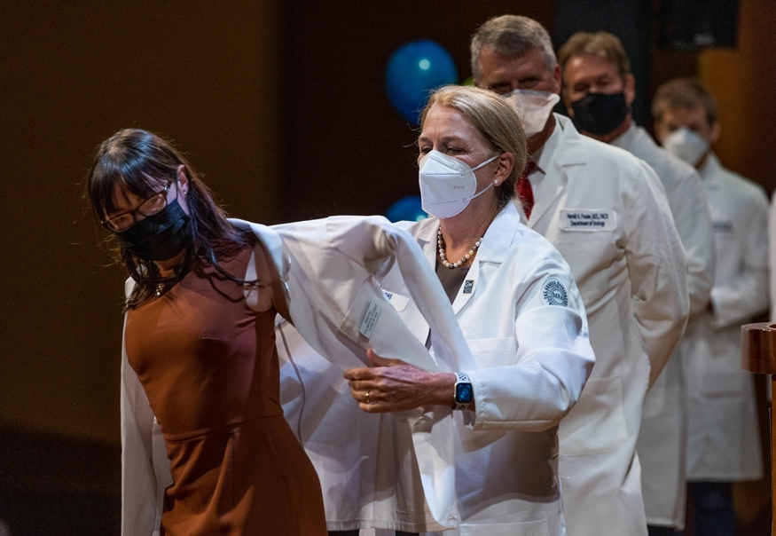 Dean Bass helping a first-year medical student into her White Coat