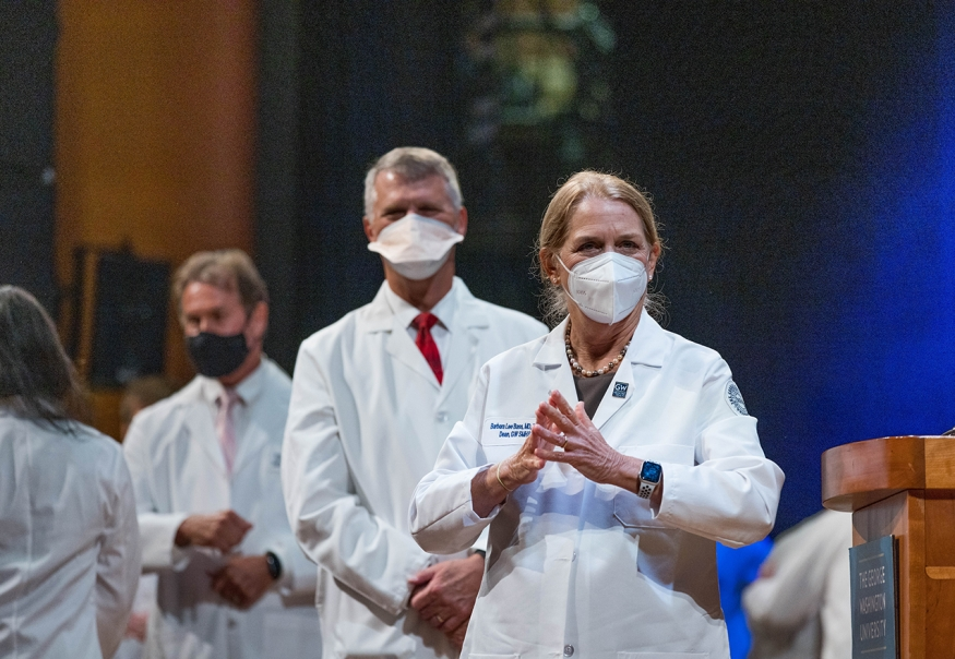Dean Bass applauds at 2021 White Coat ceremony