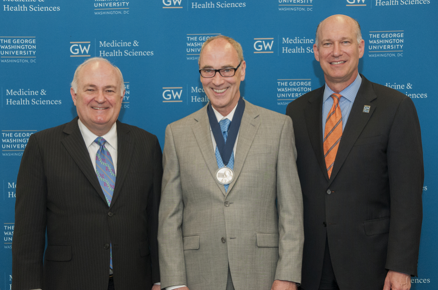 Steven Knapp, Ph.D., president of the George Washington University; Robert H. Miller, Ph.D.; and Jeffrey S. Akman, M.D. '81, RESD '85