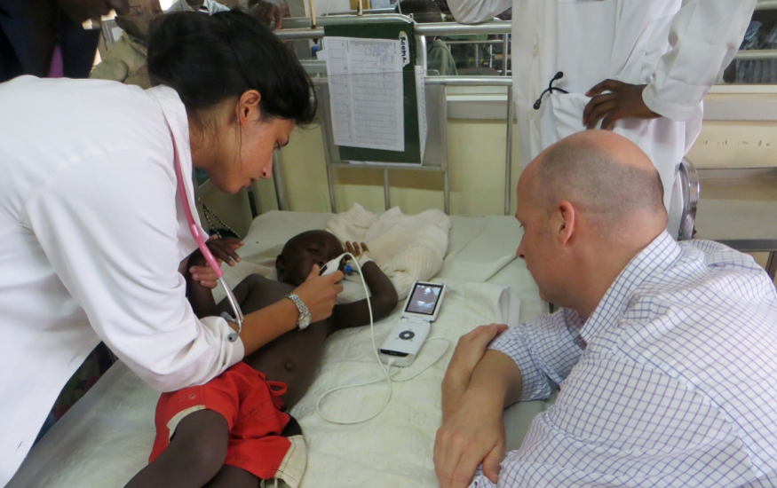 Keith Boniface, M.D., right, supervises an ultrasound.