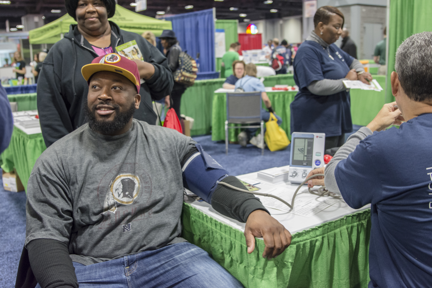 Trenin Jones gets his blood pressure taken at the GW Ron and Joy Kidney Center/GW Transplant Institute booth at the NBC4 Health and Fitness Expo on Jan. 9, 2016