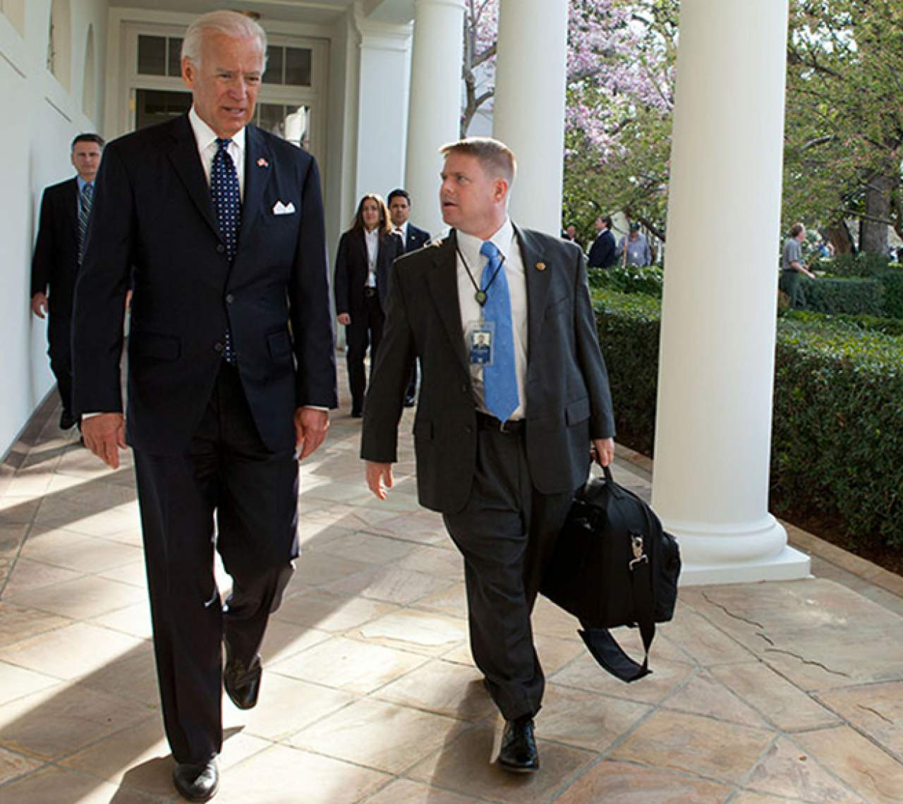 President Joe Biden walks with Physician to the President and GW professor Kevin O'Connor, DO