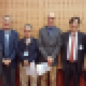 Five people standing in a room
