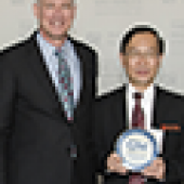 Jeffrey S. Akman, M.D., vice president for health affairs, Walter A. Bloedorn Professor of Administrative Medicine, and dean, with a delegation from Khon Kaen University in Thailand