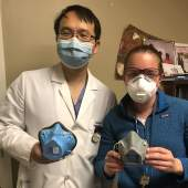 Yuan Rao and Destie Provenzano showing off the masks