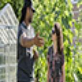 Man talking to woman in garden