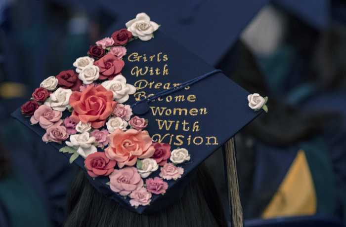 "GW SMHS Graduation Cap decorated with flowers and message ""Girls with Dreams Become Women with Vision"""