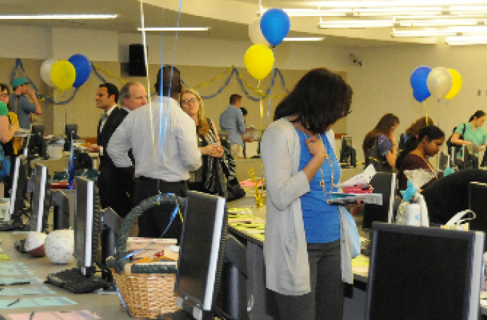 Community members peruse silent auction items