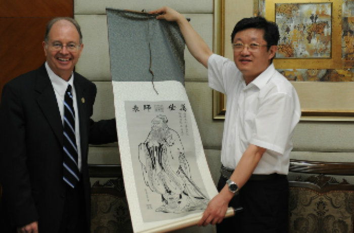 Robert G. Hawley, Ph.D. being presented with art