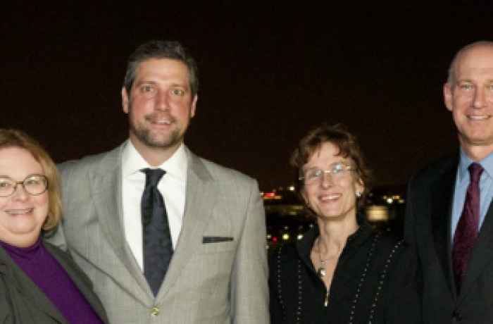 Christina M. Puchalski and Dean Akman pose for a photo with two others