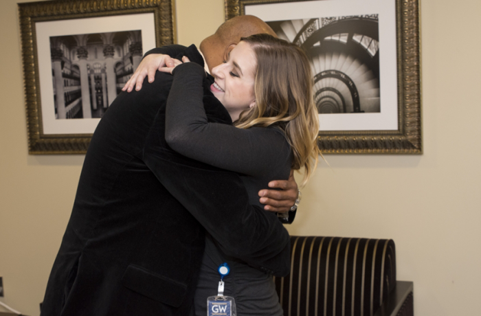 Kidney recipient Jose Reyes embraces his donor Sarah Miknis