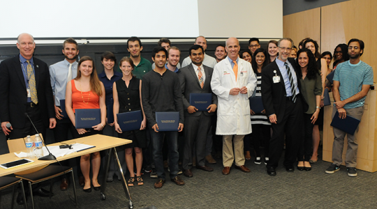 Clinical health participants pose with faculty and administrators