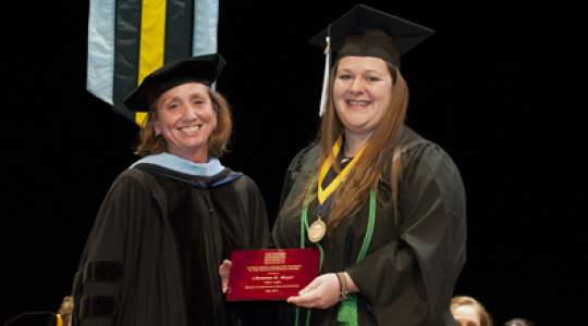 Faculty member presents student with honor