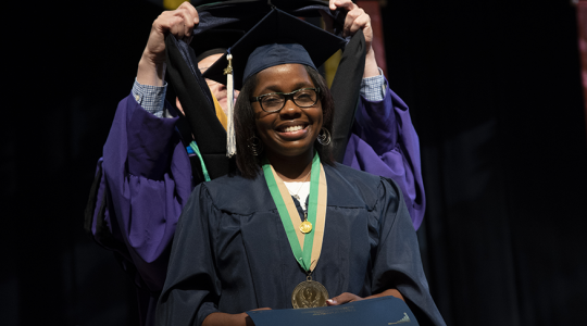 Woman smiles at graduation
