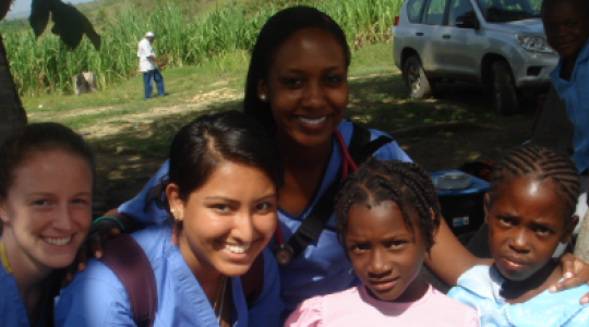 Volunteers with children in Haiti