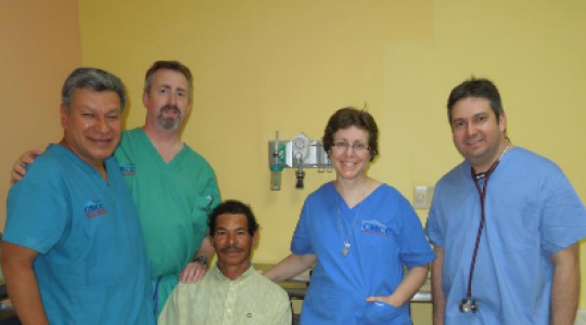 Doctors in scrubs with patient in Honduras