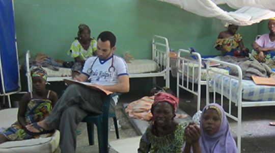 Dr. Amr Madkour sits in clinic space