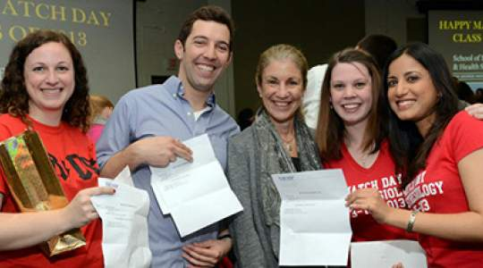 Students pose with match letters and Dean Goldberg
